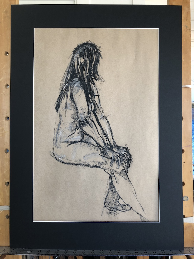 seated woman side view charcoal